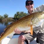 Redfish fishing with orlando charter client
