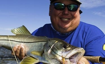 Tampa Area Charter captain holding backcountry snook