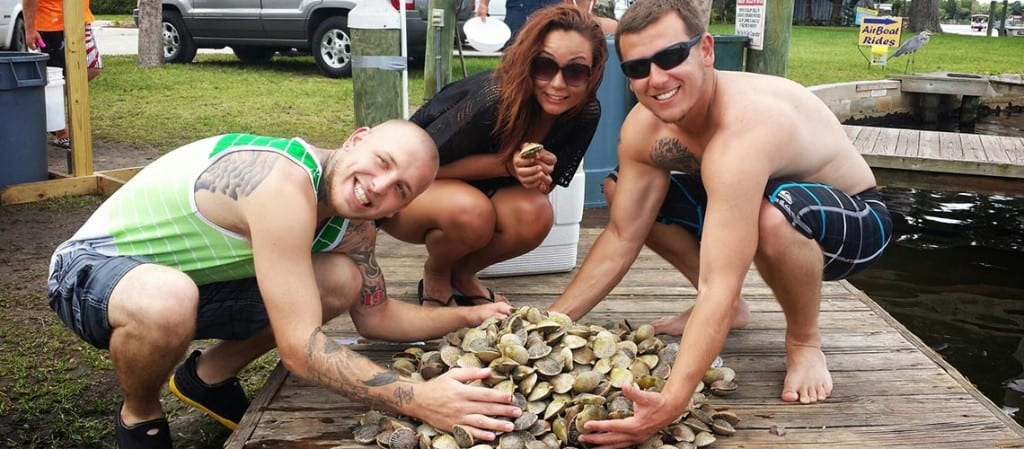 Homosassa Scalloping Charter clients happy with a pile of scallops.
